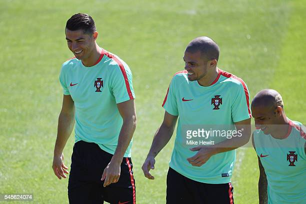 Cristiano Ronaldo and Pepe of Portugal share a joke during a Portugal training session ahead of the UEFA Euro 2016 Final between France and Portugal...