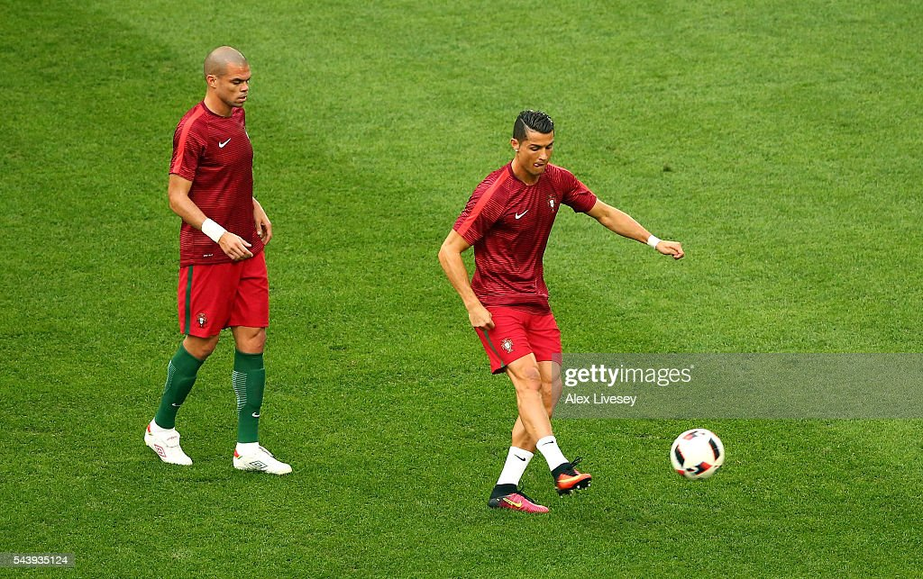 <a gi-track='captionPersonalityLinkClicked' href=/galleries/search?phrase=Cristiano+Ronaldo+-+Soccer+Player&family=editorial&specificpeople=162689 ng-click='$event.stopPropagation()'>Cristiano Ronaldo</a> (R) and <a gi-track='captionPersonalityLinkClicked' href=/galleries/search?phrase=Pepe+-+Portuguese+Soccer+Player&family=editorial&specificpeople=4401229 ng-click='$event.stopPropagation()'>Pepe</a> (L) of Portugal warm up prior to the UEFA EURO 2016 quarter final match between Poland and Portugal at Stade Velodrome on June 30, 2016 in Marseille, France.
