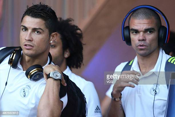 Cristiano Ronaldo and Pepe of Real Madrid arrive at Shanghai Stadium prior to the International Champions Cup football match between AC Milan and...