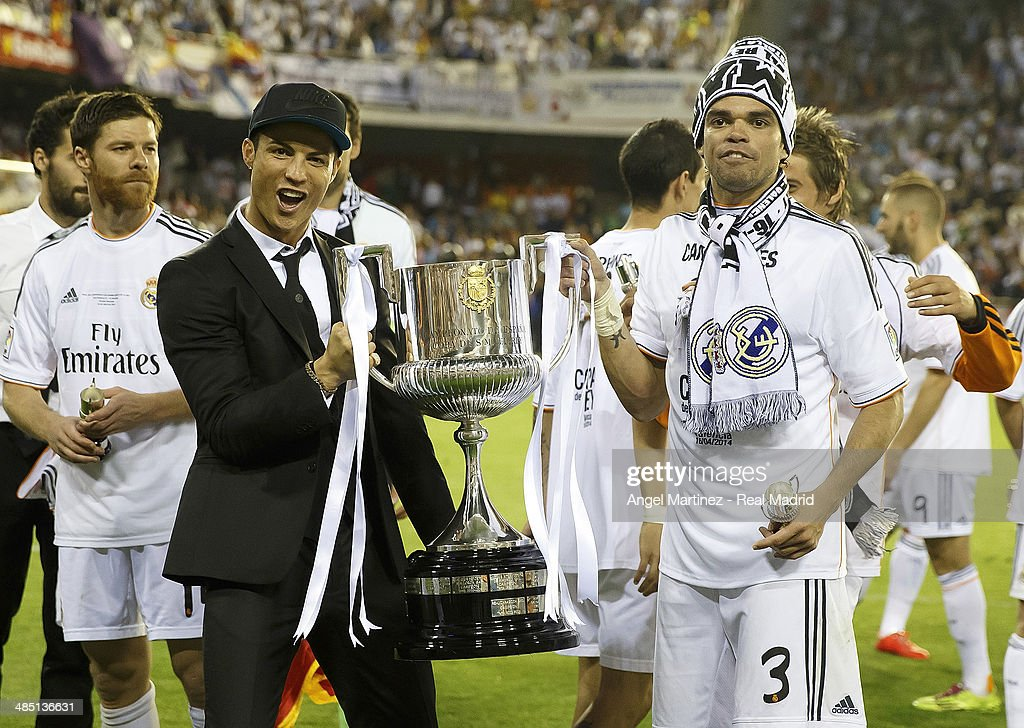 Cristiano Ronaldo (L) and Pepe of Real Madrid celebrate with the trophy after the Copa del Rey Final between Real Madrid and Barcelona at Estadio Mestalla on April 16, 2014 in Valencia, Spain.
