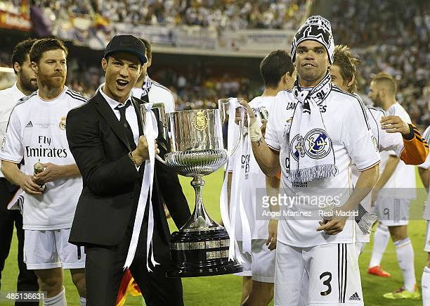 Cristiano Ronaldo and Pepe of Real Madrid celebrate with the trophy after the Copa del Rey Final between Real Madrid and Barcelona at Estadio...