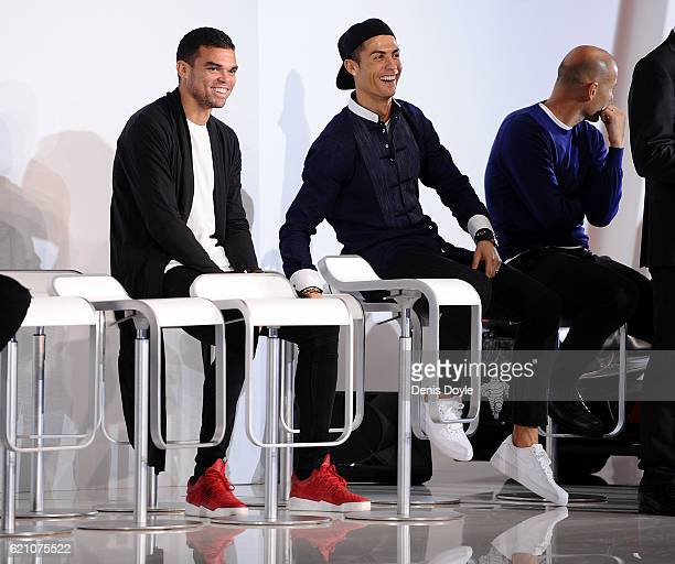 Cristiano Ronaldo and Pepe of Real Madrid chat during a promotional event by the German carmaker Audi at Carlos Sainz Center on November 4 2016 in...