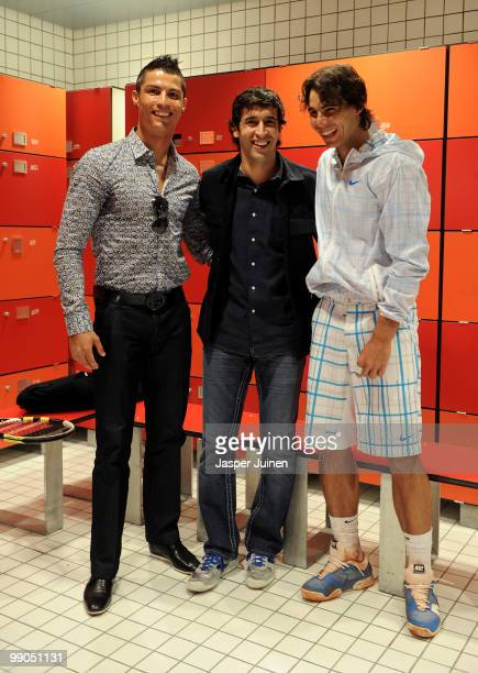 Cristiano Ronaldo and Raul Gonzalez of Real Madrid chat with Rafael Nadal of Spain after his second round match during the Mutua Madrilena Madrid...