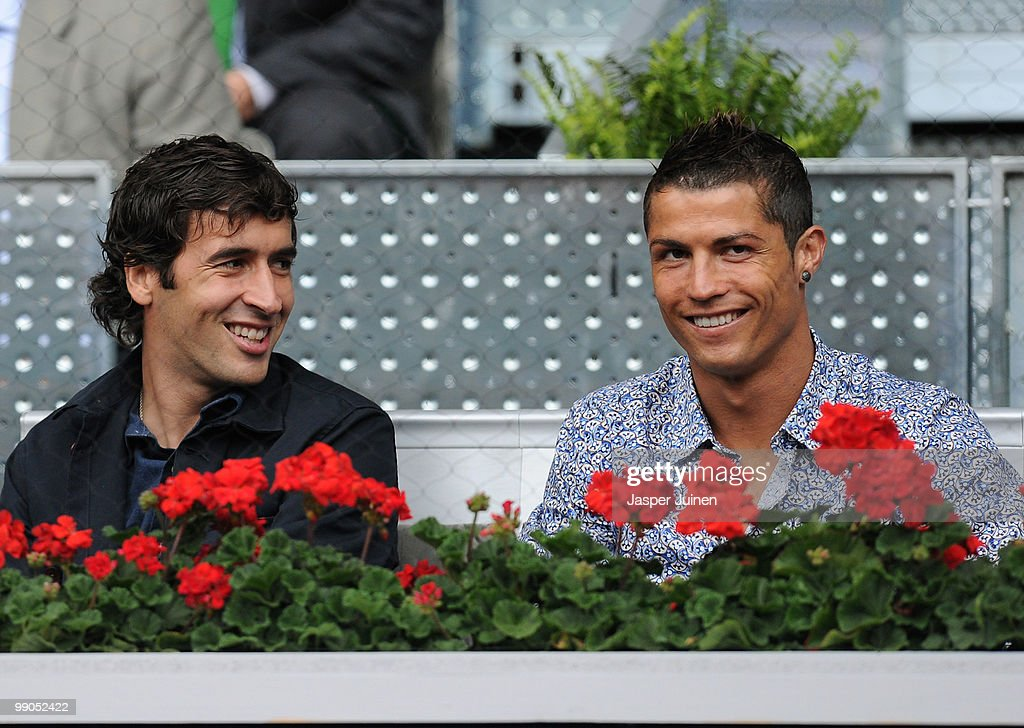 Cristiano Ronaldo and Raul Gonzalez of Real Madrid smile during the second round match between Rafael Nadal of Spain and Oleksandr Dolgopolov of...