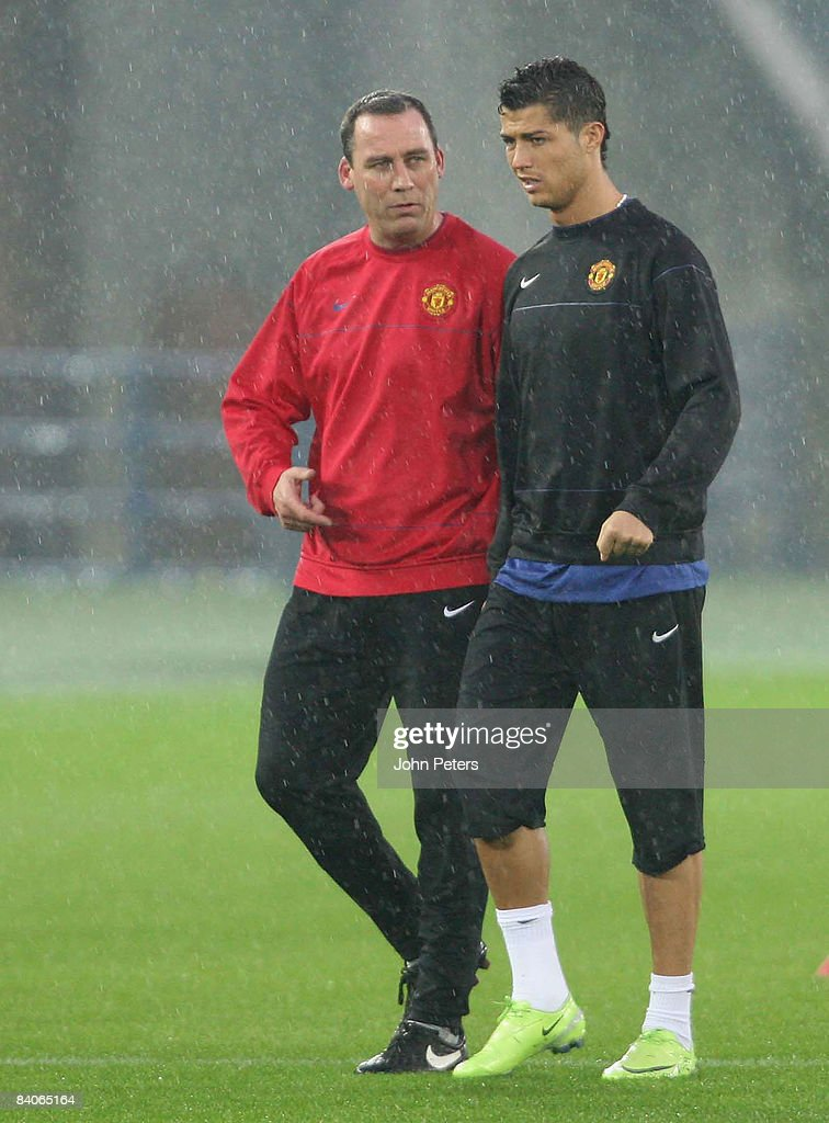 Cristiano Ronaldo and Rene Meulensteen of Manchester United take part in a First Team Training Session ahead of the World Club Cup at Yokohama International Stadium on December 17 2008 in Yokohama, Japan.