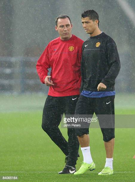 Cristiano Ronaldo and Rene Meulensteen of Manchester United take part in a First Team Training Session ahead of the World Club Cup at Yokohama...