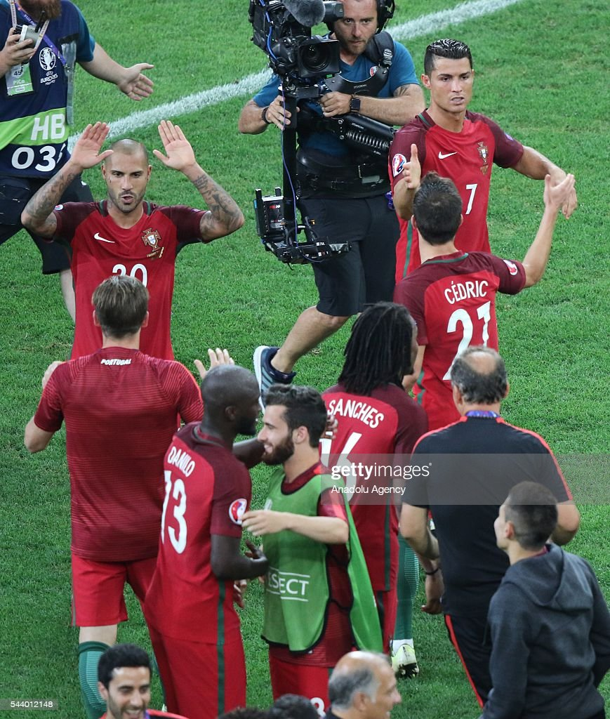 Cristiano Ronaldo and Ricardo Querasma of Portugal celebrate after winning the Euro 2016 quarter-final football match between Poland and Portugal at the Stade Velodrome in Marseille on June 30, 2016.