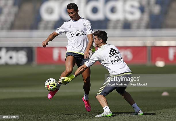 Cristiano Ronaldo and Ruben Yanez of Real Madrid in action during a training session at Valdebebas training ground on August 11 2015 in Madrid Spain