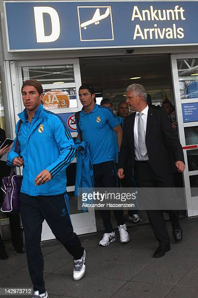 Cristiano Ronaldo and Sergio Ramos of Real Madrid arrives with her team at Munich airport´FranzJosef Strauss´ on April 16 2012 in Munich Germany Real...