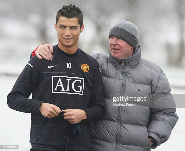 Cristiano Ronaldo and Sir Alex Ferguson of Manchester United in action during a first team training session at Carrington Training Ground on February...