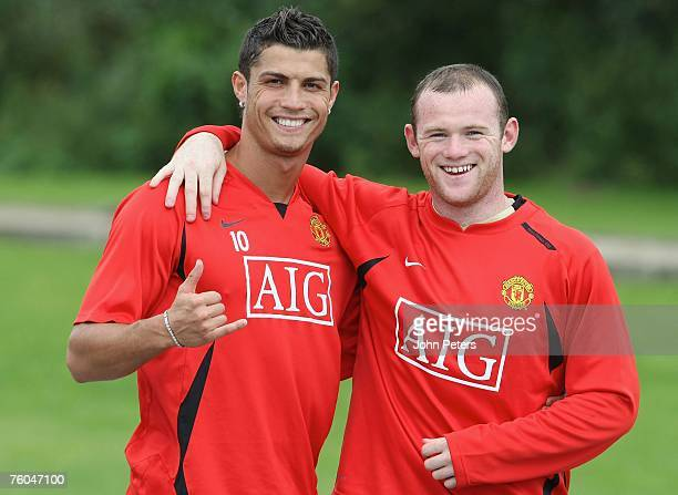 Cristiano Ronaldo and Wayne Rooney of Manchester United pose during a First Team Training Session at Carrington Training Ground on August 7 2007 in...