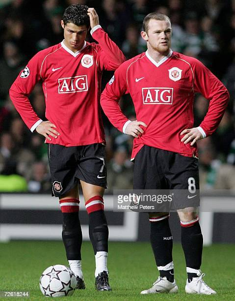 Cristiano Ronaldo and Wayne Rooney of Manchester United show their disappointment after conceding a goal during the UEFA Champions League match...