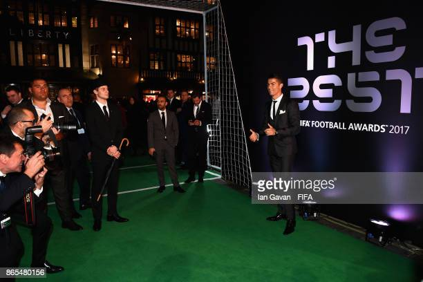 Cristiano Ronaldo arrives on the green carpet for The Best FIFA Football Awards at The London Palladium on October 23 2017 in London England