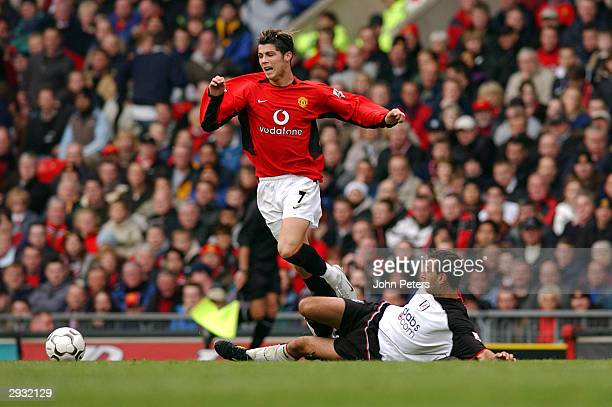 Cristiano Ronaldo avoids a tackle during the FA Barclaycard Premiership match between Manchester United v Fulham on October 25 2003 in Manchester...