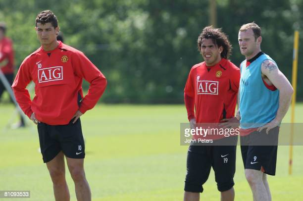Cristiano Ronaldo Carlos Tevez and Wayne Rooney of Manchester United in action during a First Team Training Session at Carrington Training Ground on...