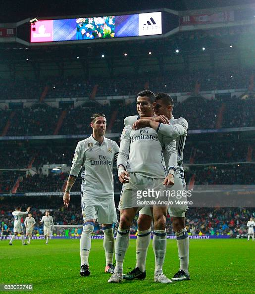 Cristiano Ronaldo celebrates scoring their second goal with teammate Carlos Casemiro and Sergio Ramos during the La Liga match between Real Madrid CF...