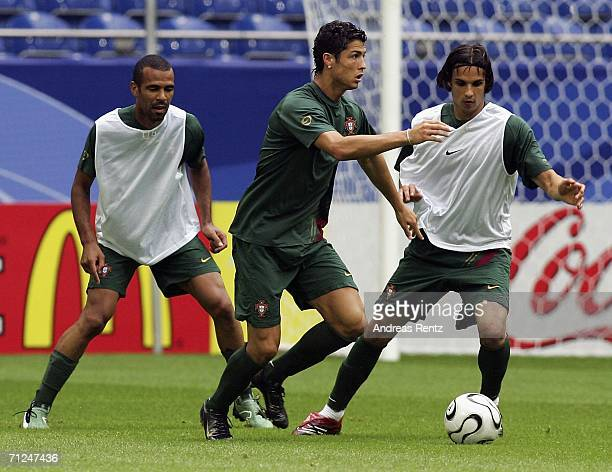 Cristiano Ronaldo challenges for the ball with Costinha and Nuno Gomes during a Portugal national team training session on June 20 2006 in...