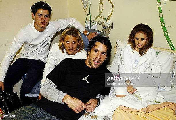 Cristiano Ronaldo Diego Forlan and Ruud van Nistelrooy pose with Casey Ogden during the annual players' visit to childrens' hospitals on December 18...