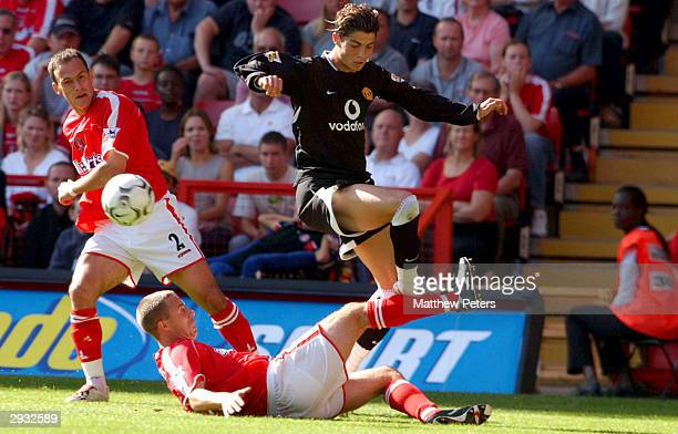 Cristiano Ronaldo evades the tackle of Chris Perry during the FA Barclaycard Premiership match between Charlton Athletic v Manchester United at The...