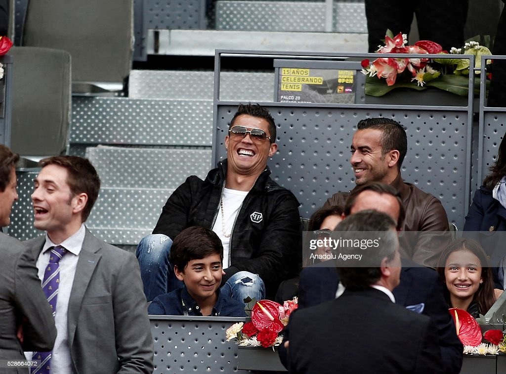 Cristiano Ronaldo (C) football player of Real Madrid watches Rafael Nadal of Spain and Joao Sousa of Portugal quarter final round match at the Mutua Madrid Open tennis tournament at the Caja Magica in Madrid, Spain on May 06, 2016.