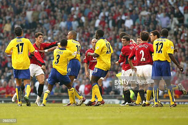 Cristiano Ronaldo is confronted by Arsenal players at the final whistle during the FA Barclaycard Premiership match between Manchester United v...