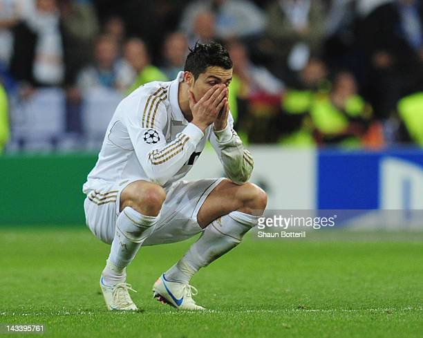 Cristiano Ronaldo is dejected after missing his penalty during the UEFA Champions League second leg semifinal match between Real Madrid and Bayern...
