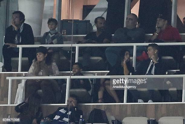 Cristiano Ronaldo is seen in tribune with his mother Maria Dolores dos Santos Aveiro his son Cristiano Ronaldo JR and Georgina Rodriguez during the...