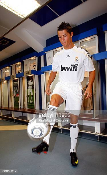 Cristiano Ronaldo juggles a football while wearing a Real Madrid football kit before his official presentation as new Real Madrid player at the...
