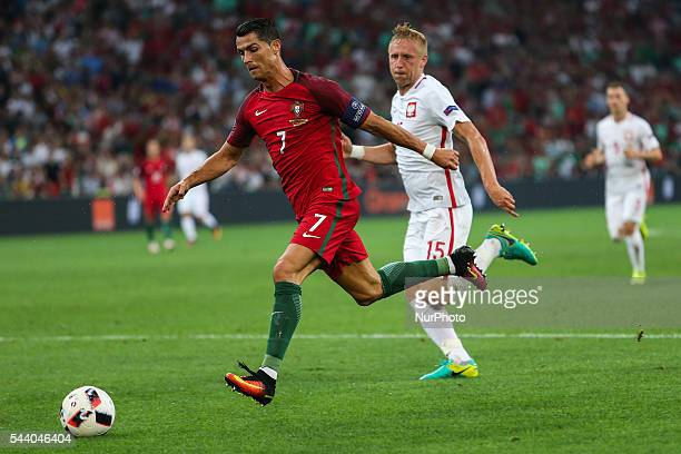 Cristiano Ronaldo Kamil Glik during the UEFA EURO 2016 quarter final match between Poland and Portugal at Stade Velodrome on June 30 2016 in...