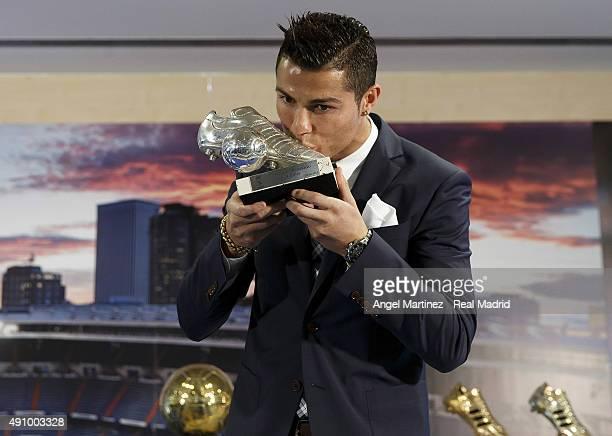 Cristiano Ronaldo kisses his trophy as alltime top scorer of of Real Madrid CF at Honour boxseat of Santiago Bernabeu Stadium on October 2 2015 in...