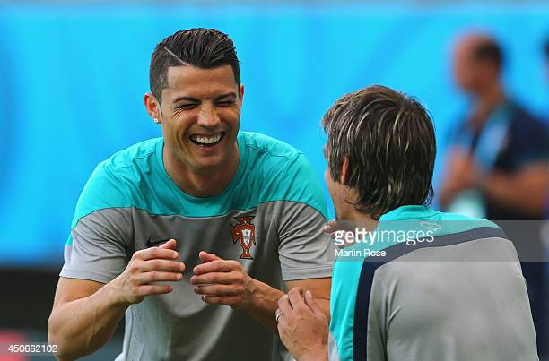 Cristiano Ronaldo laughs during the Portugal training session ahead of the 2014 FIFA World Cup Group G match between Germany and Portugal held at the...