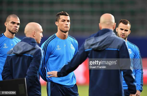 Cristiano Ronaldo looks on as Zinedine Zidane manager of Real Madrid speaks during a Real Madrid training session ahead of their UEFA Champions...