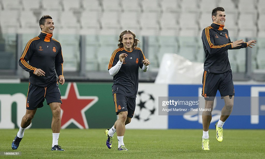 Cristiano Ronaldo, Luka Modric and Gareth Bale of Real Madrid run during a training session ahead of their UEFA Champions League Group B match against Juventus at Juventus Arena on November 4, 2013 in Turin, Italy.