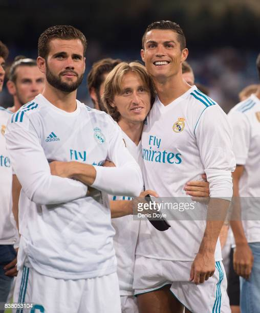 Cristiano Ronaldo Luka Modric and Nacho of Real Madrid CF celebrate after Real beat ACF Fiorentina 21 to win the Santiago Bernabeu Trophy match...