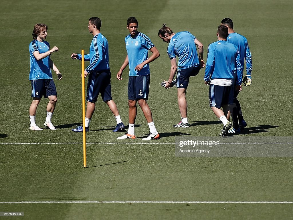Cristiano Ronaldo (2nd L), Luka Modric (L), Gareth Bale (3rd R) and Raphael Varane (3rd L) of Real Madrid attends training session ahead of UEFA Champions League semi-final second leg football match between Real Madrid CF and Manchester City at Valdebebas training ground in Madrid, Spain on May 3, 2016.