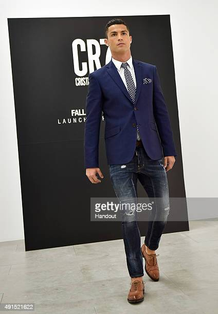 Cristiano Ronaldo makes his catwalk debut to model new styles at the global launch of his FW15 CR7 Footwear collection on October 5 2015 in Guimaraes...