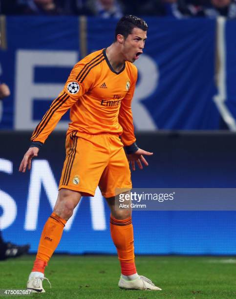 Cristiano Ronaldo of Madrid celebrates his team's sixth goal during the UEFA Champions League Round of 16 first leg match between FC Schalke 04 and...