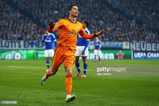 Cristiano Ronaldo of Madrid celebrates his team's third goal during the UEFA Champions League Round of 16 first leg match between FC Schalke 04 and...