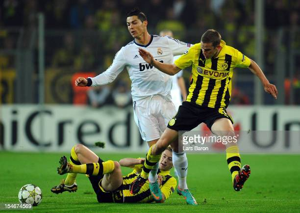 Cristiano Ronaldo of Madrid is challenged by Marco Reus and Sven Bender of Dortmund during the UEFA Champions League group D match between Borussia...