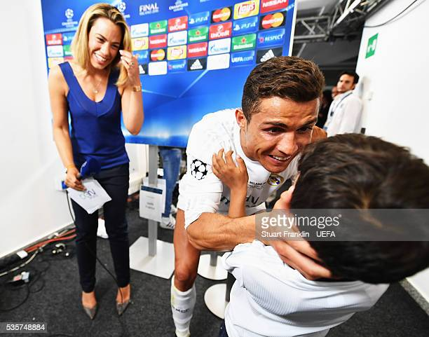 Cristiano Ronaldo of Madrid is intervirewed with his son Cristiano Ronaldo Jr after the UEFA Champions League Final match between Real Madrid and...
