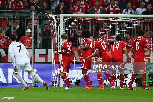 Cristiano Ronaldo of Madrid scores his team's fourth goal during the UEFA Champions League semi final match between FC Bayern Muenchen and Real...