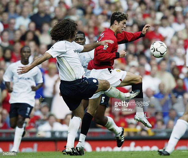 Cristiano Ronaldo of Man Utd clashes with Ivan Campo of Bolton during the FA Barclaycard Premiership match between Manchester United and Bolton...