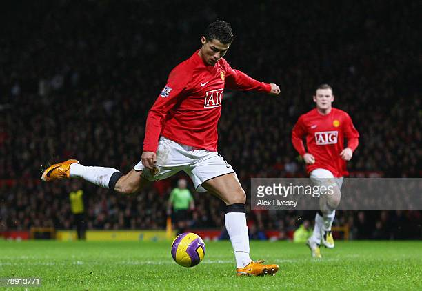 Cristiano Ronaldo of Manchester shoots and scores his team's third goal during the Barclays Premier League match between Manchester United and...