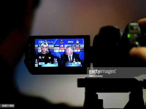 Cristiano Ronaldo of Manchester United and Sir Alex Ferguson are seen in the viewfinder of a camera during a press conference held at Old Trafford on...
