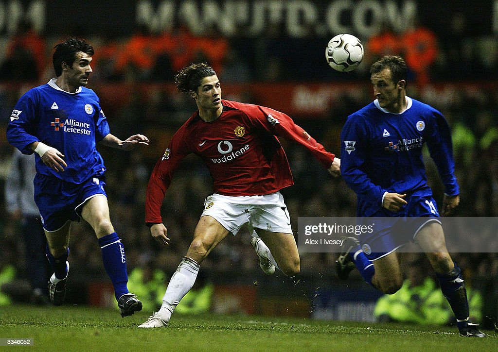 <a gi-track='captionPersonalityLinkClicked' href=/galleries/search?phrase=Cristiano+Ronaldo+-+Soccer+Player&family=editorial&specificpeople=162689 ng-click='$event.stopPropagation()'>Cristiano Ronaldo</a> of Manchester United beats Keith Gillespie (left) and Riccardo Scimeca (right) of Leicester City during the FA Barclaycard Premiership match between Manchester United and Leicester City at Old Trafford on April 13, 2004 in Manchester, England.