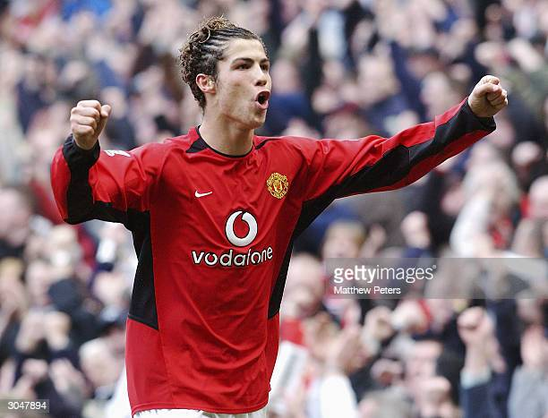 Cristiano Ronaldo of Manchester United celebrates his part in Ruud van Nistelrooy's second goal during the FA Cup Quarter Final match between...