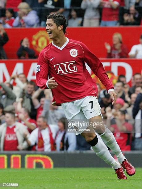 Cristiano Ronaldo of Manchester United celebrates Ole Gunnar Solskjaer scoring the first goal during the Barclays Premiership match between...