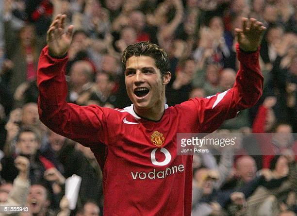 Cristiano Ronaldo of Manchester United celebrates Ruud van Nistelrooy scoring the first goal during the Barclays Premiership match between Manchester...