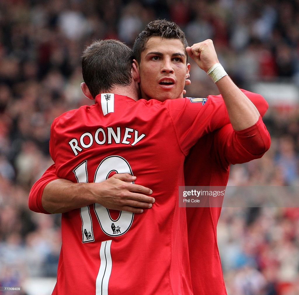Cristiano Ronaldo of Manchester United celebrates scoring his second goal with Wayne Rooney during the Barclays Premier League match between Manchester United and Wigan Athletic at Old Trafford on October 06, 2007 in Manchester, England.