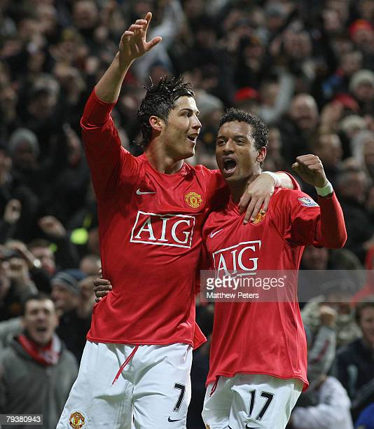 Cristiano Ronaldo of Manchester United celebrates scoring his team's first goal during the Barclays FA Premier League match between Manchester United...